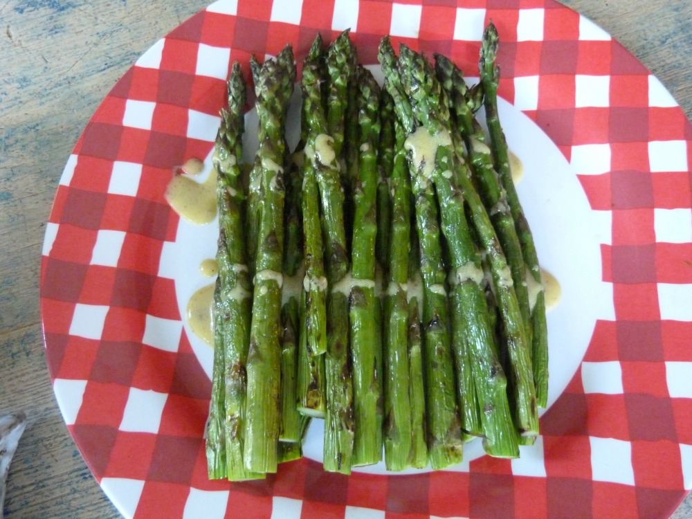 Grilled asparagus drizzled with mustard vinaigrette.