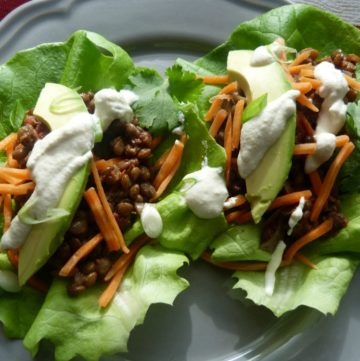 "Large lettuce leaves filled lentil taco ""meat"", vegan sour cream and avocado slices"