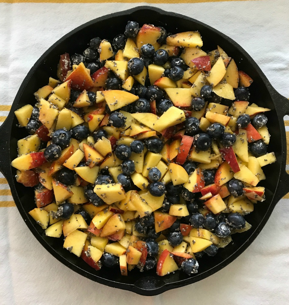 Cast Iron skillet loaded with nectarines, blueberries and chia seeds
