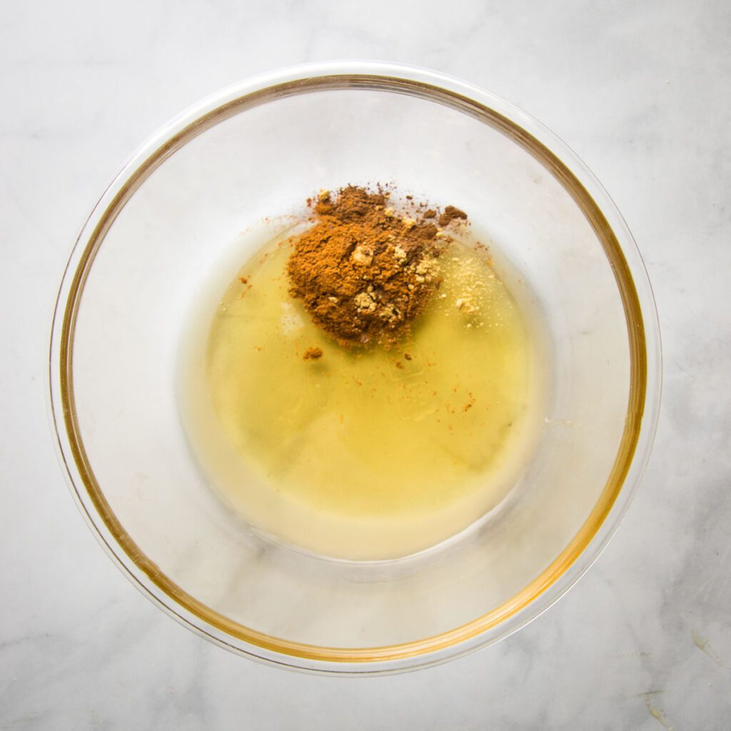 Spices, lemon juice and honey in a large glass bowl