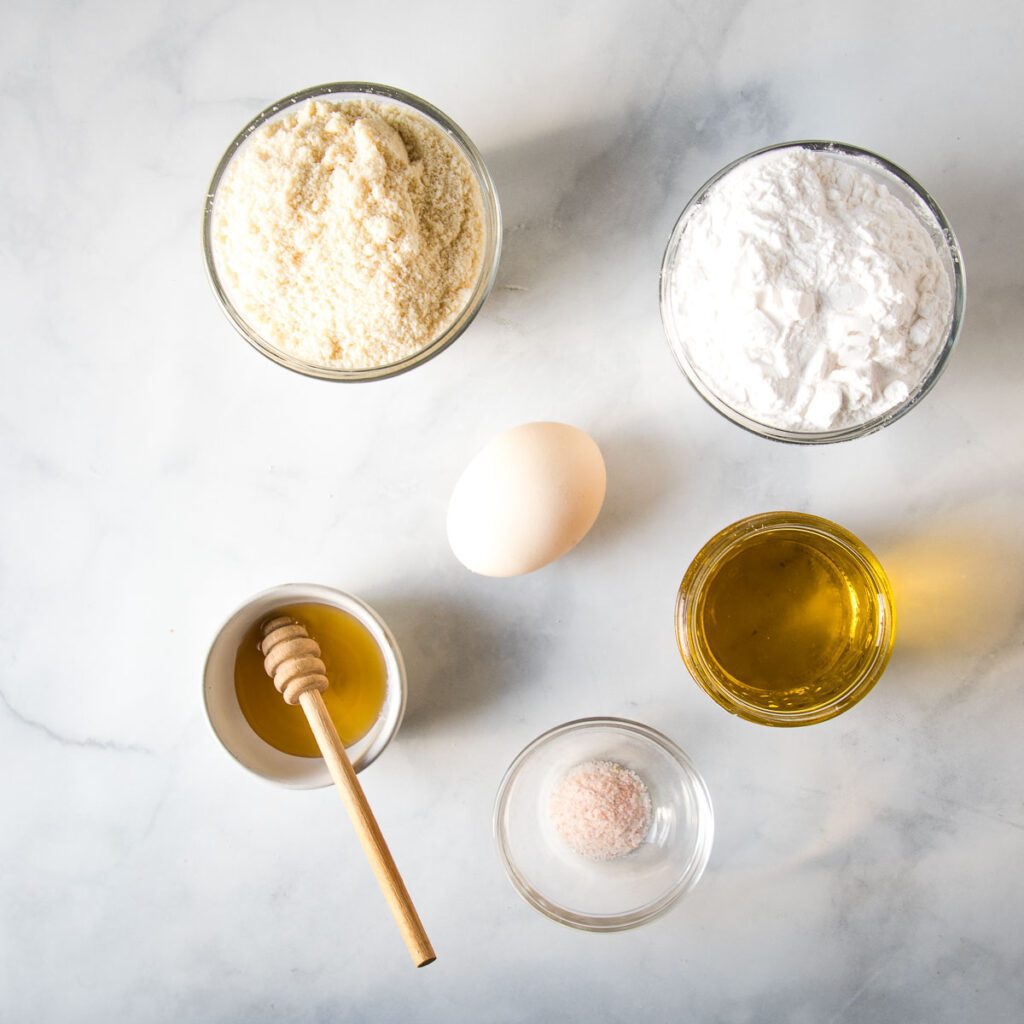 Ingredients for a gluten-free galette crust: almond flour, arrowroot powder, honey, olive oil, salt and an egg.