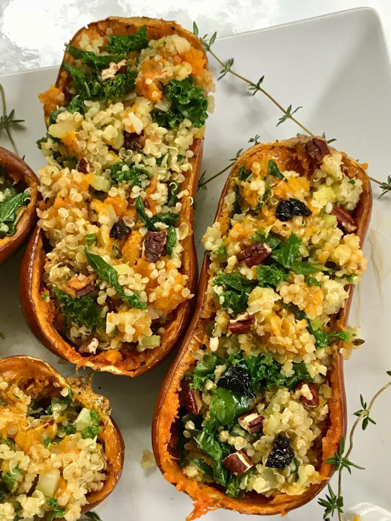 Stuffed butternut squash with quinoa, kale and dried cherries.