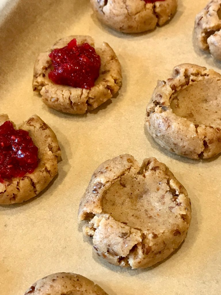 Filling cookies with jam.