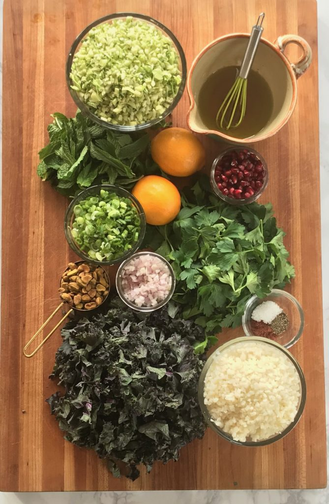 Whole ingredients:  riced broccoli and cauliflower, fresh herbs, lemons, shallots, pomegranate seeds, kale, pistachios.