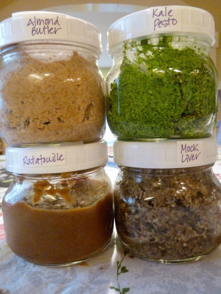 Jars labeled with almond butter, kale pesto, ratatouille and mock liver.
