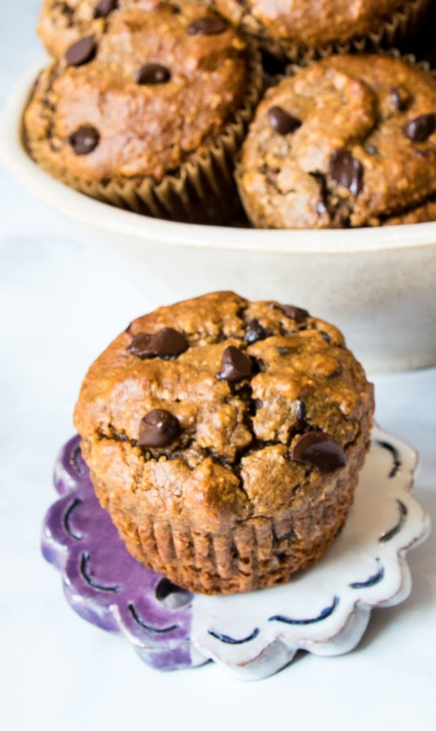Chocolate Chip Muffin with a bowl full in the background.