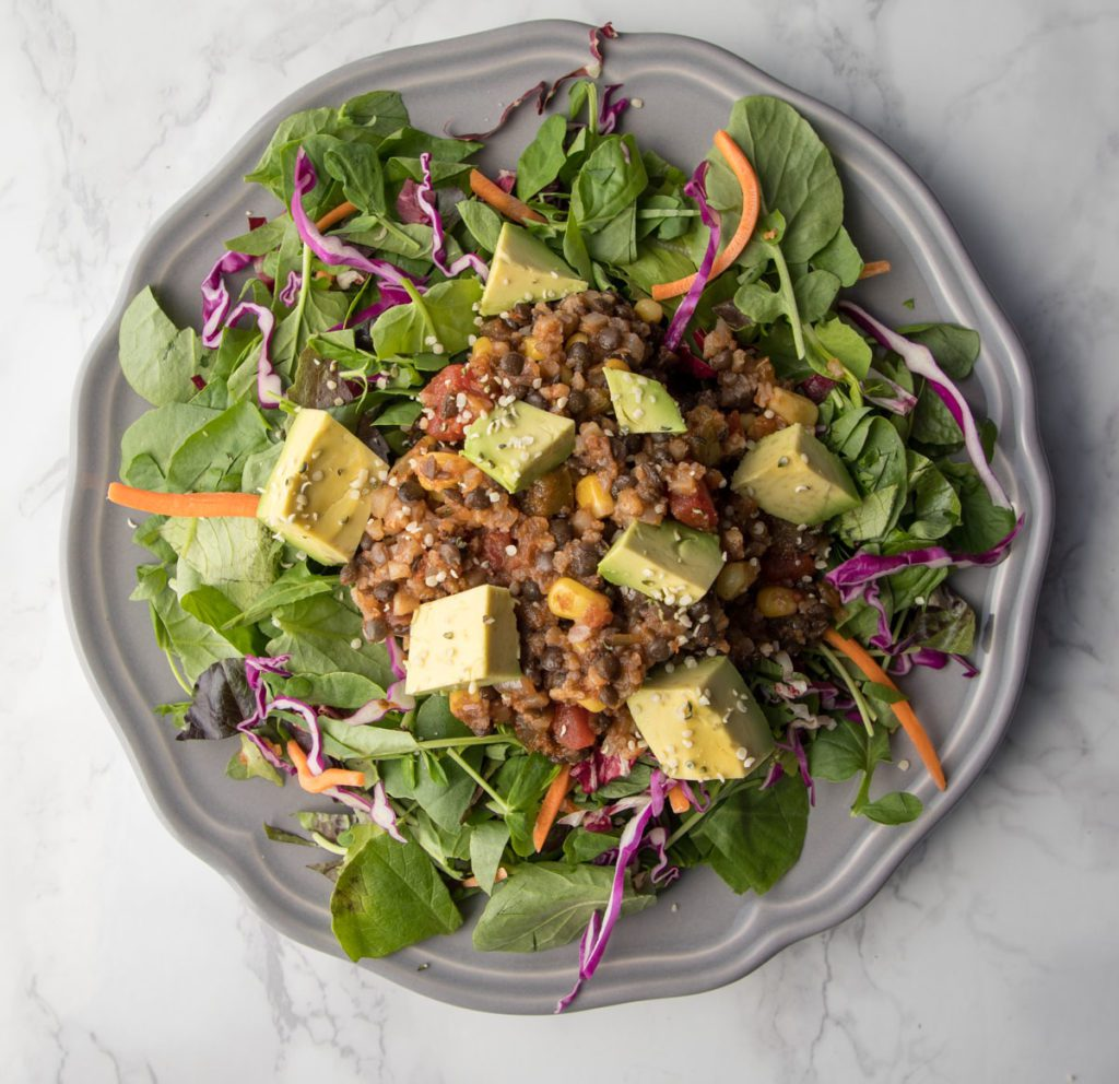 Lentil and Cauli-Rice Stuffing on top of greens for a taco salad.