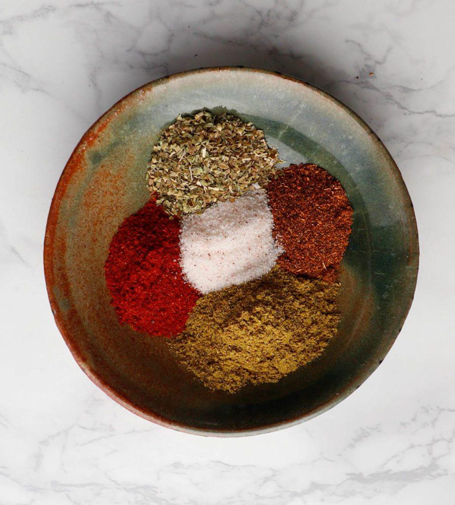 Taco spices: cumin, paprika, chili powder and oregano.