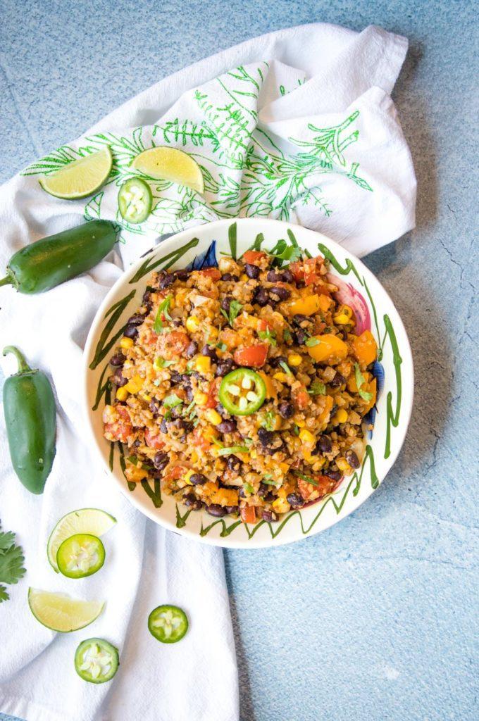 Jalapenos, limes and bowl of cauli-rice