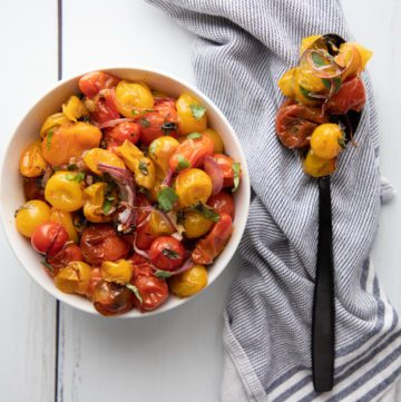 A spoonful of colorful roasted cherry tomatoes