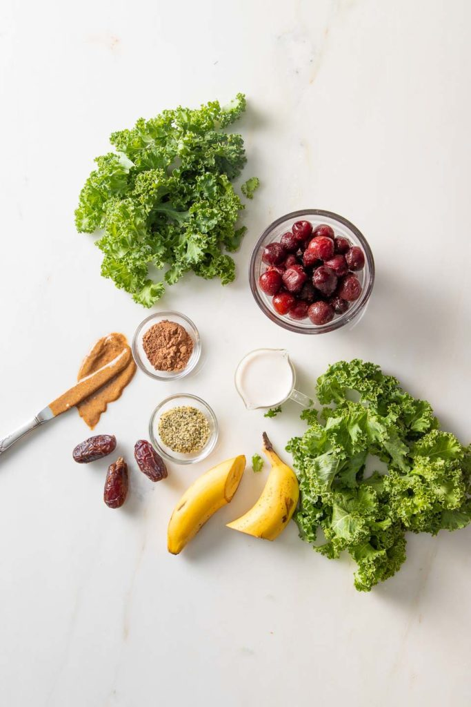 Greens, banana, dates, cherries, almond butter