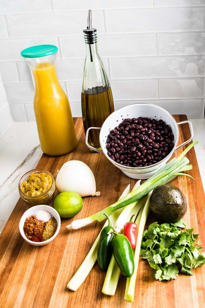 Veggie broth, beans, cilantro, celery, onions, garlic, jalapenos and spices.