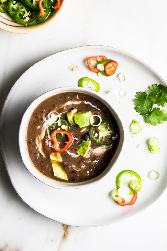Black Bean Soup with a swirl of vegan yogurt.