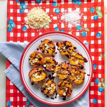 Grilled peaches with chocolate and nuts