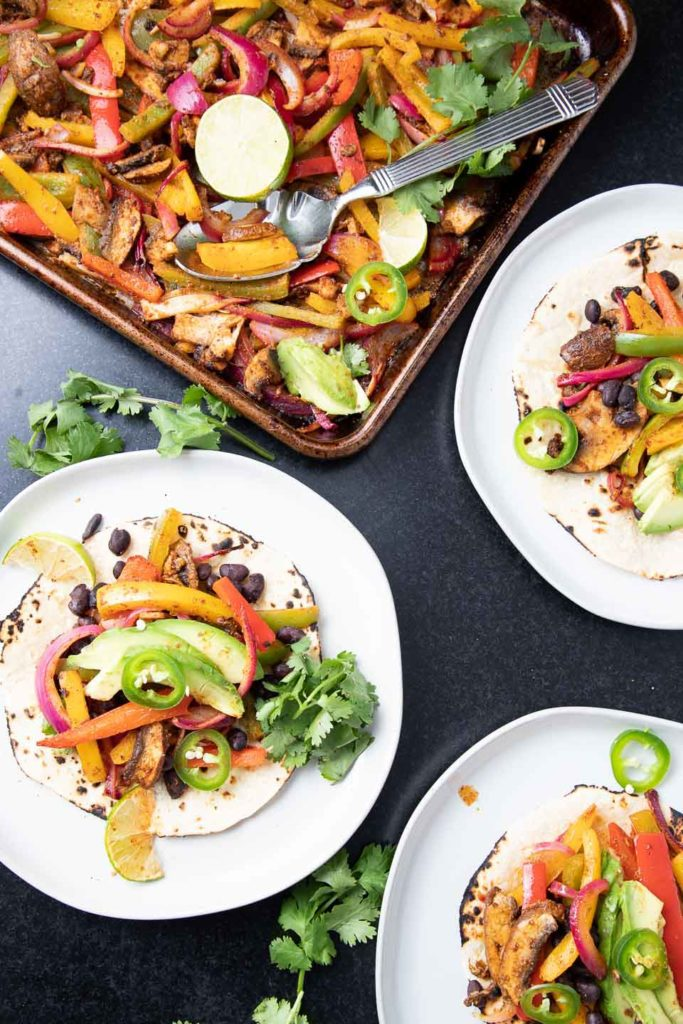 Roasted veggies on shells with avocado