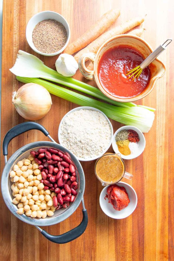 Ingredients for a vegan meatloaf include beans, oats, flax, spices and veggies.
