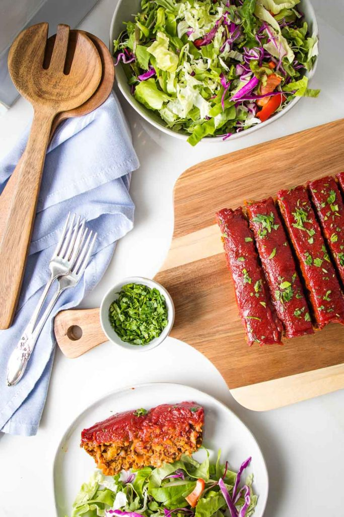 A healthy meal that includes salad and meatless meatloaf.