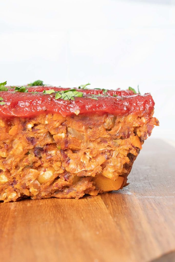 Side view of a slice of vegan meatloaf.