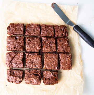 Brownies cut into squares with one missing.