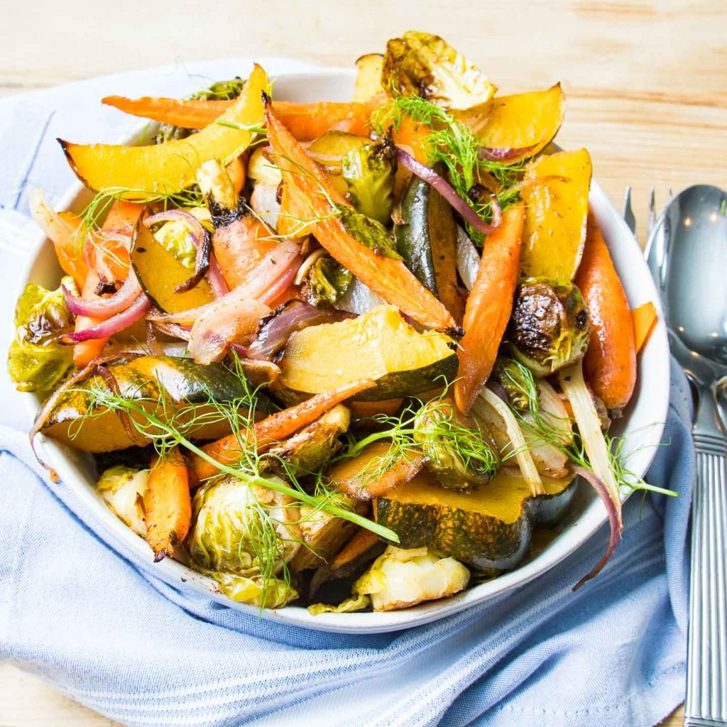 Yellow Squash, Orange Carrots, Green Brussels Sprouts, Fennel and Fennel Fronds. Bright and colorful in a bowl.