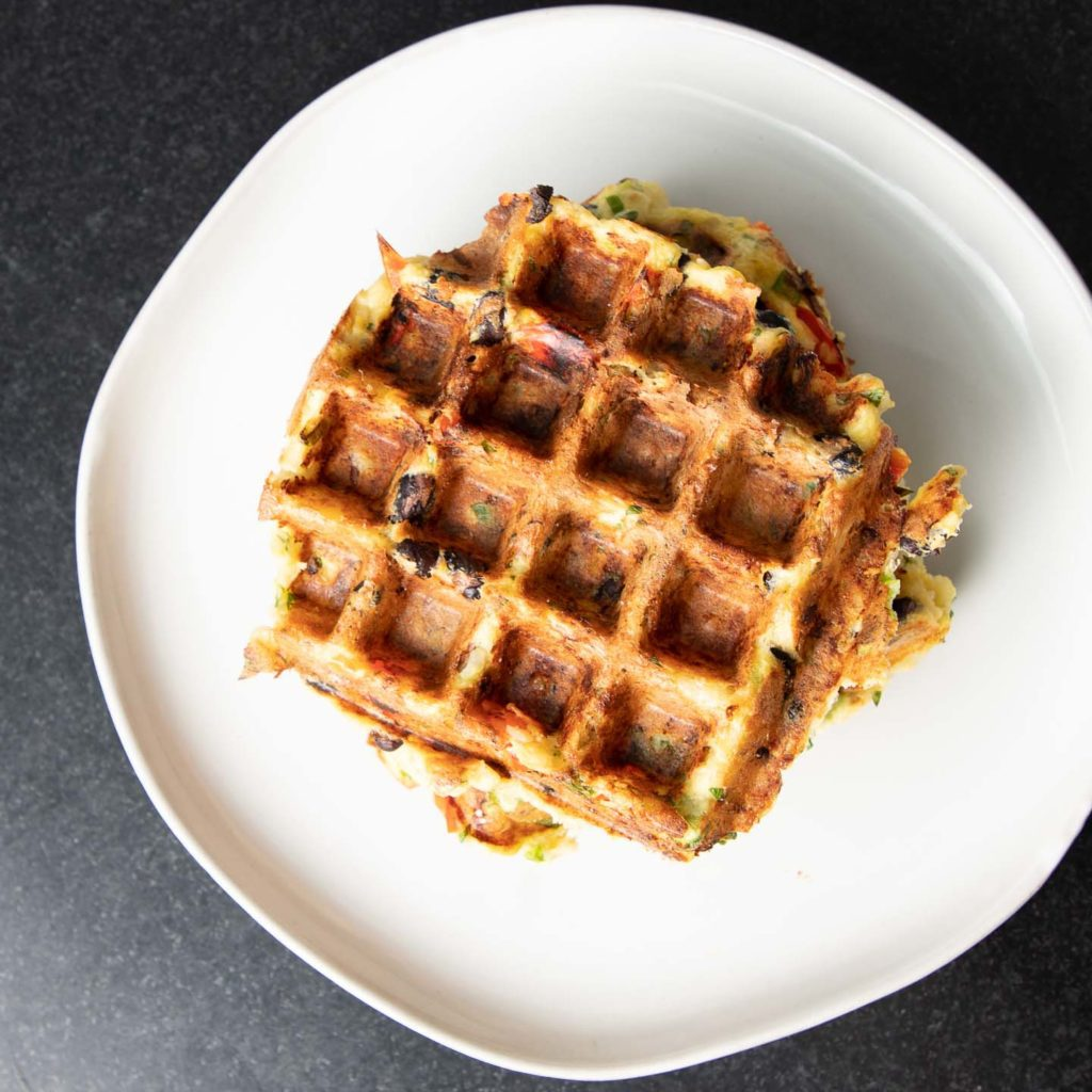 Crispy waffle with color flecks from veggies.