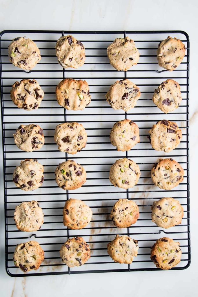 Chocolate Chunk Cookies cooling on a wire rack.