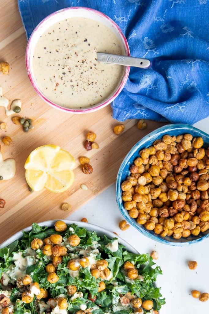 Crunchy Roasted Chickpeas on top of kale plus creamy caesar dressing.