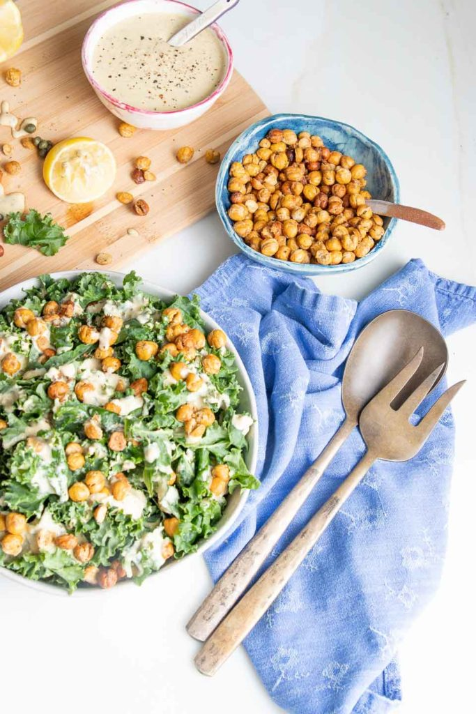 A colorful display of kale salad with creamy dressing and crunchy croutons