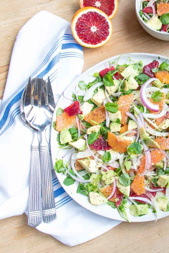 Bright blood oranges added to salad.