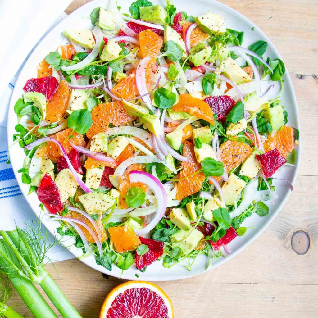 Bright and beautiful chopped citrus and veggies.