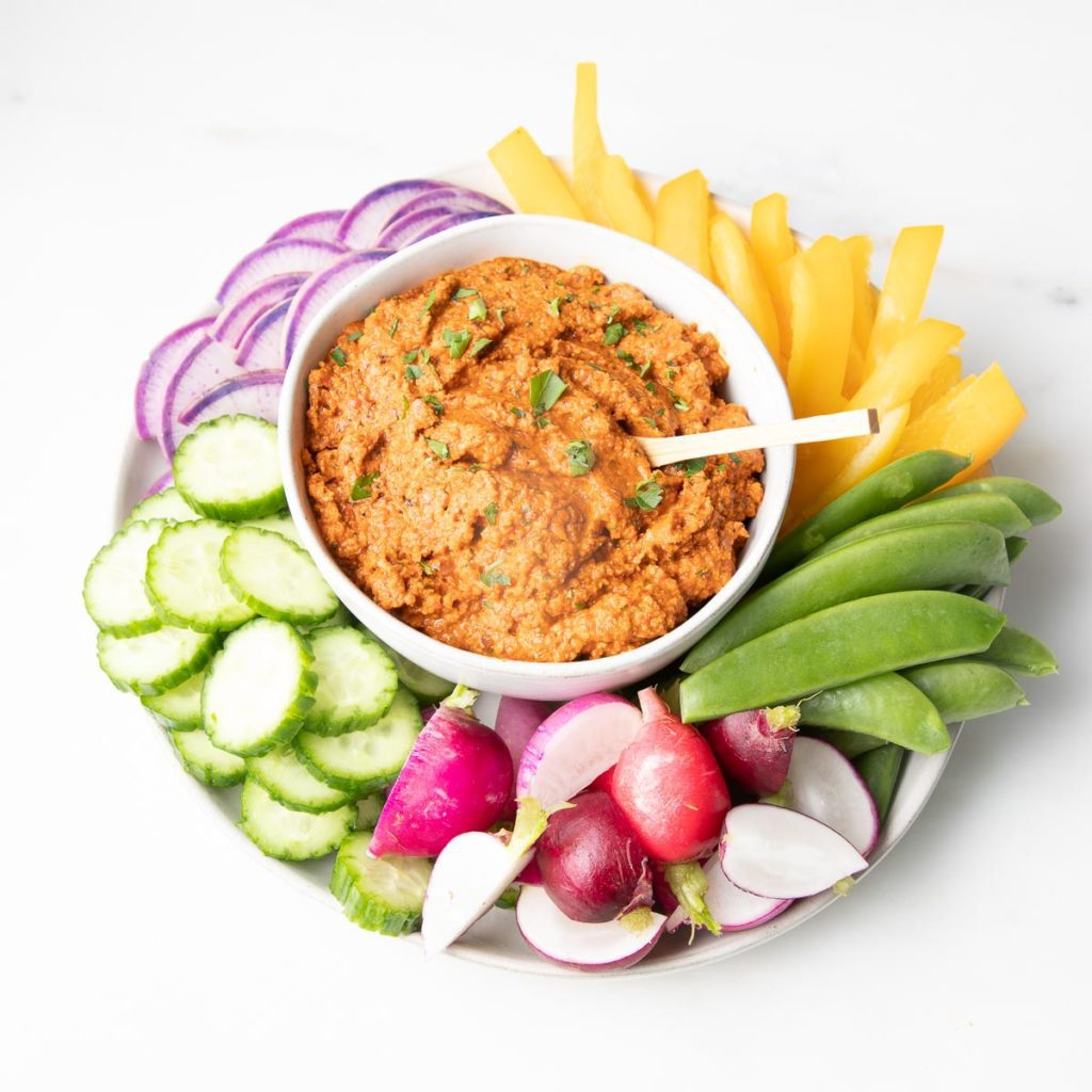 Brightly colored vegetables and dip