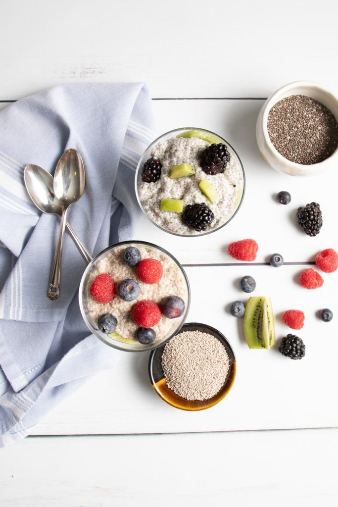 Two parfaits, one with black, one with white chia seeds.