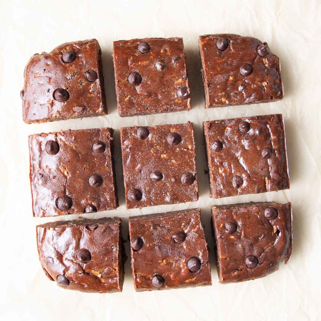 Close up of chocolate zucchini brownies cut into squares.