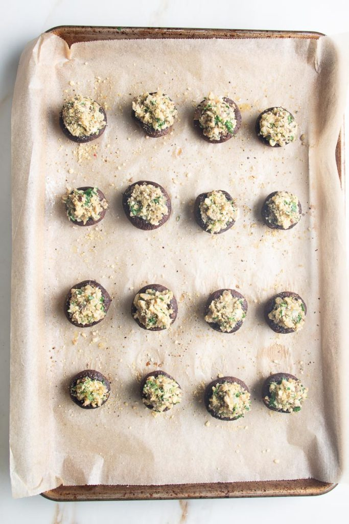 Baking tray with gluten-free stuffed mushrooms