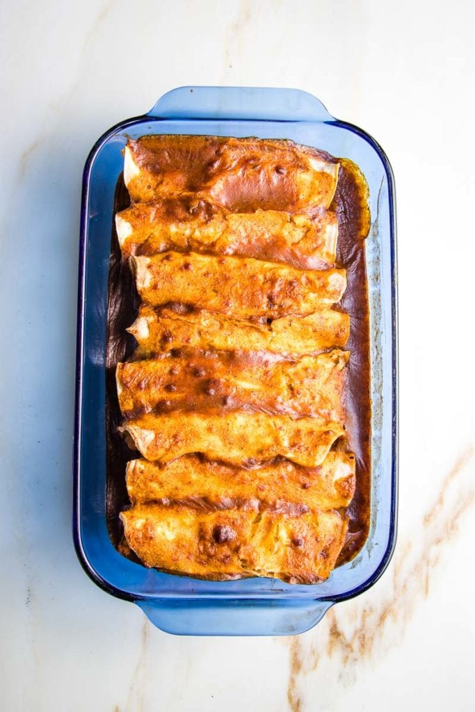 enchilada casserole with red sauce, baked in a casserole dish.