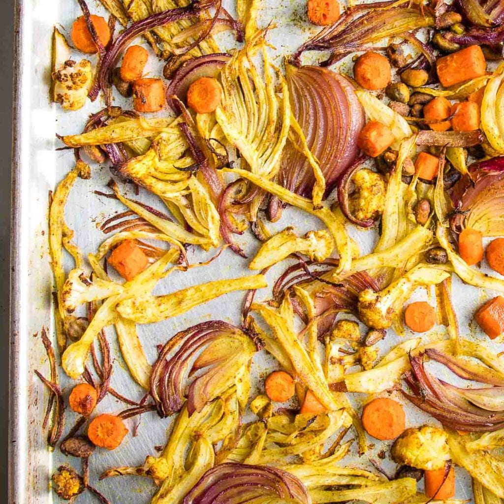 Sheet Pan of roasted, caramelized fennel, onions, carrots, cauliflower plus pistachios.