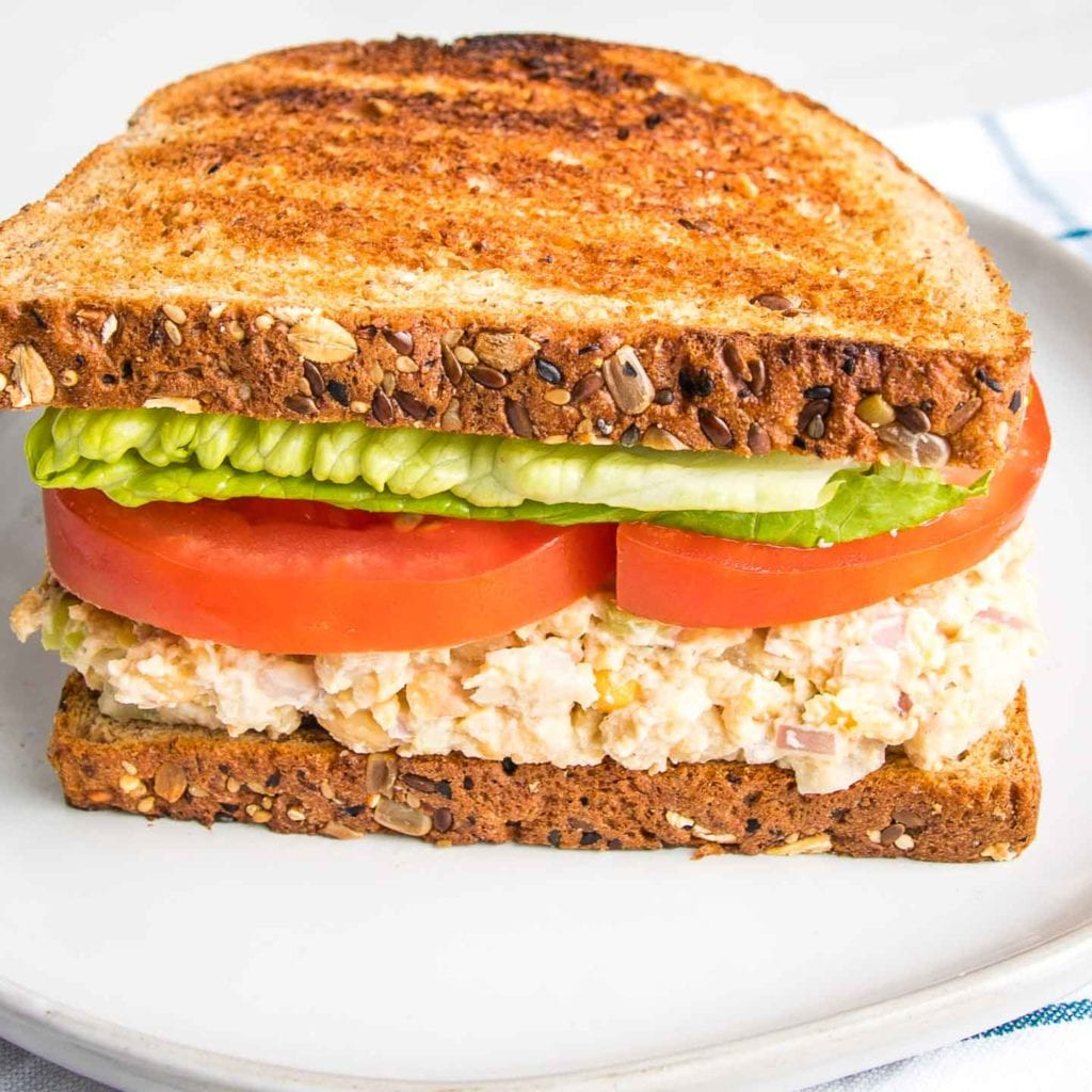 Vegan Tuna Salad on toasted bread with lettuce and tomato.