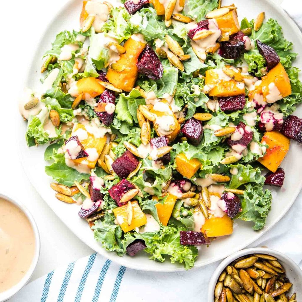 Bright green kale, brilliant orange roasted butternut squash, ruby red roasted beets, plus toasted sunflower seeds and a creamy balsamic dressing drizzled over this salad.