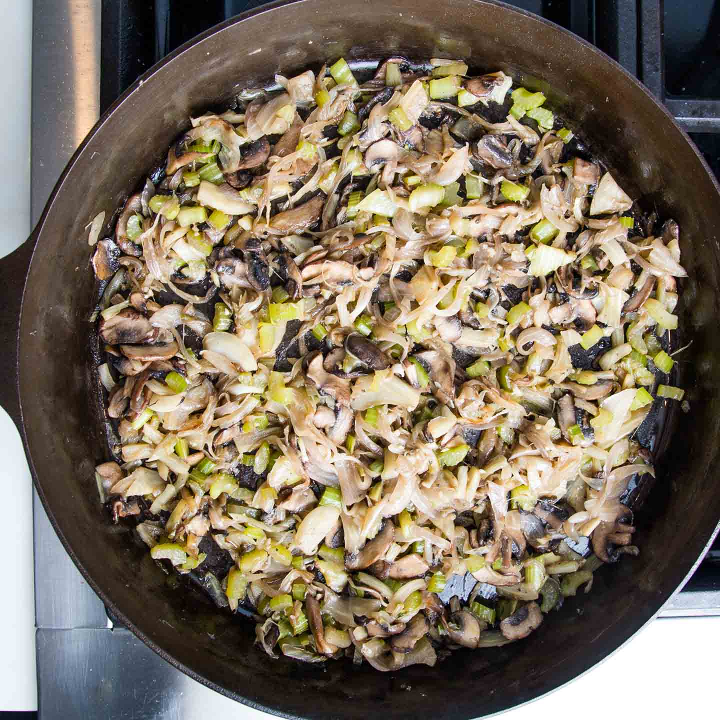 Sauteed veggies in cast iron skillet.  Mushrooms, fennel, celery and onions.