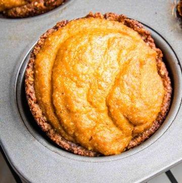 Close up of a mini pumpkin pie in a muffin tin.