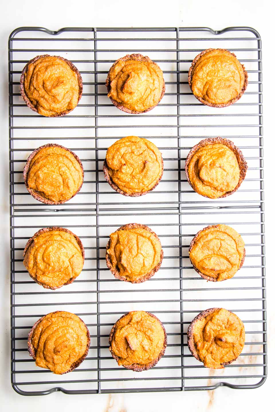 Mini Pumpkin Pies cooling on a wire rack.