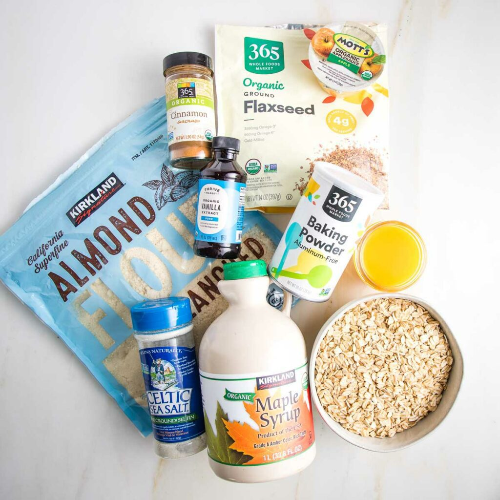 Ingredients for blueberry crumble bars: almond flour, oats, maple syrup, flax seeds, apple sauce, baking powder, vanilla, cinnamon and orange juice.