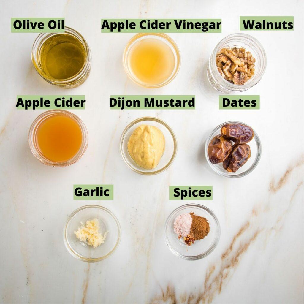 Tagged photos of ingredients for Apple Vinaigrette: Olive oil, apple cider vinegar, walnuts, apple cider, dijon mustard, dates, garlic, spices.