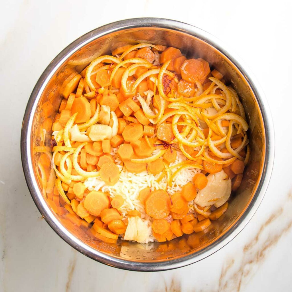 Cooked rice, carrots, orange peels and garlic in the instant pot